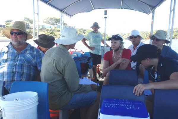 Friends of Moore River Estuary receive instruction from Department of Water on measuring water quality parameters.