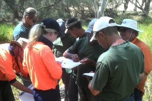 Prison team work with Central Regional TAFE Talapia project team to monitor aquatic invasive species.