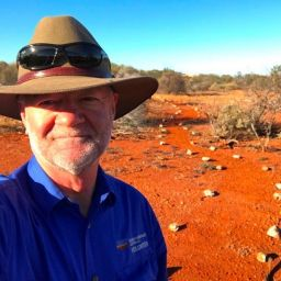 Richard McLellan NACC CEO in a paddock in the outback