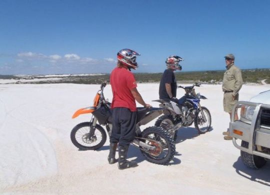 Local ranger Paul Robb discussing options with riders of unregistered ORV's.