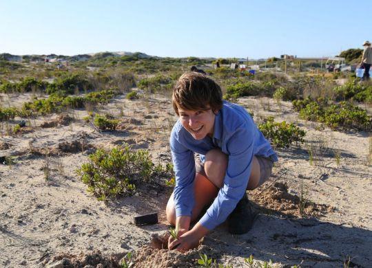 NACC NRM Officer Heather Legge planting some seedlings