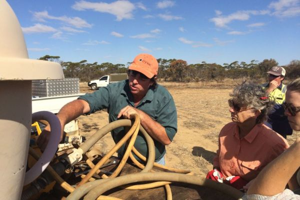 Phil Logue from Perenjori Farming Forward showing local community members the different types of firefighting equipment.
