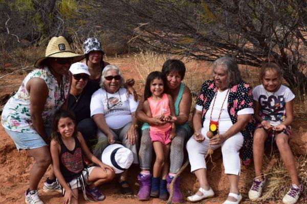 Dann family collecting gulyu (bush potatoe) on country.