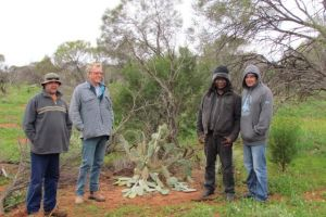 Some of the participants of the ranger team spin yarns with NACC's Aboriginal Participation Program coordinator Greg Burrows (2nd left)