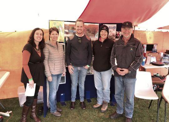 The NACC team celebrates the rain at the Perenjori Agricultural Show.