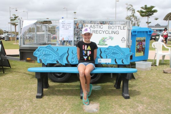 Young Phoebe Teakle correctly guessed the number of bottles in a compressed cube to win this seat made from recycled plastic at Geraldton's Big Beach Clean-up – she donated it to her school.