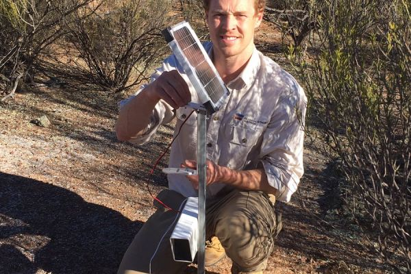 Bush Heritage's Will Hansen setting up motion-senor cameras for their National Adaptive Management Malleefowl Project