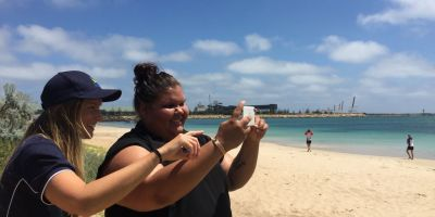 Aboriginal intern Paula Slater receiving training on the intricacies of using Photomon for beach monitoring.