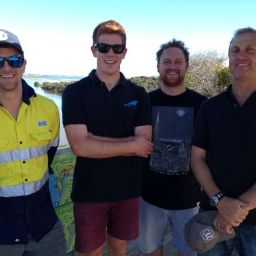 Staff from Port Denison based naval architecture and marine design company, Southerly Designs take in the view post planting along the Irwin River