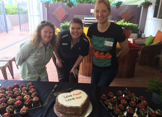 NACC's Sarah Jeffery and Sally Fenner with Tina Schroeder and the World Soil Day cake