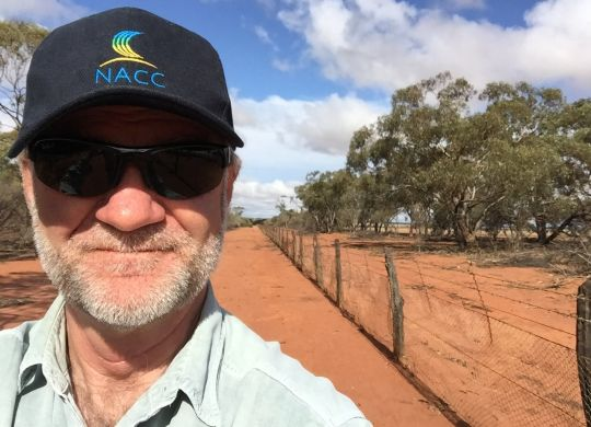 Richard in NACC cap at the Rabbit proof fence